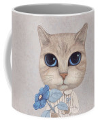 A Cat With A Blue Flower Coffee Mug