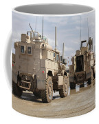 A Convoy Of Mrap Vehicles Near Camp Coffee Mug