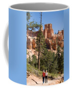 A Couple Hikes Along A Trail In Bryce Coffee Mug
