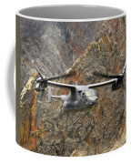 A Cv-22 Osprey Flies Over The Canyons Coffee Mug by Stocktrek Images