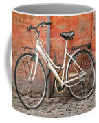 A Dejected Bicycle Waits Patiently On A Cobbled Street In Rome. Coffee Mug