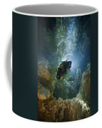 A Diver Ascends A Deep Shaft In Dans Coffee Mug by Wes C. Skiles