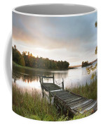 A Dock On A Lake At Sunrise Near Wawa Coffee Mug