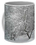 A Dogwood Sleeps While The Snow Falls Coffee Mug