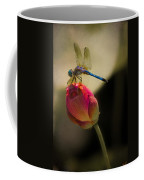 A Dragonfly Rests Momentarily On A Lotus Bud Coffee Mug