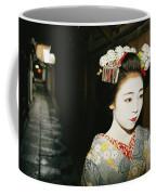 A Geisha In Traditional Costume Walks Coffee Mug by Paul Chesley