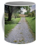 A Gravel Road Marks The Entranceexit Coffee Mug by Joel Sartore