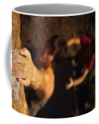 A Hand Catches A Hand Hold On A Boulder Coffee Mug