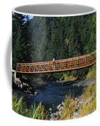 A Hiker Crosses A Bridge Coffee Mug
