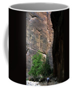 A Hiker Walks Among The Narrow Coffee Mug
