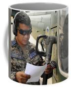 A Honduran Crew Chief Consults Coffee Mug
