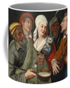 A Lady Holding A Swaddled Cat A Man With A Pan Of Porridge Another Playing With Fire Irons And Two O Coffee Mug