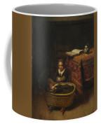 A Little Girl Rocking A Cradle Coffee Mug