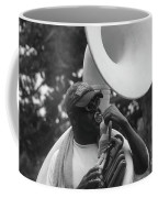A Man Blows His Horn Coffee Mug