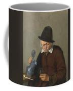 A Man Holding A Tankard And A Glass Coffee Mug