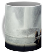 A Man Relaxes At A Fountain Coffee Mug by Stacy Gold