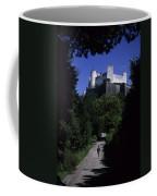 A Man Walks Toward The Salzburg Castle Coffee Mug by Taylor S. Kennedy