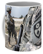 A Military Police Officer Provides Coffee Mug by Stocktrek Images