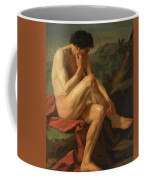 A Naked Man Sitting In A Landscape Coffee Mug
