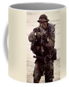 A Navy Seal Exits The Water Armed Coffee Mug