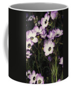 A Patch Of Wildflowers With White Coffee Mug