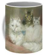 A Persian Cat And Her Kittens Coffee Mug by Maud D Heaps