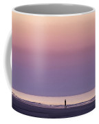 A Person Walks On The Beach At Sunrise Coffee Mug