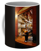 A Pint Of Dark Beer Sits In A Pub Coffee Mug by Jim Richardson