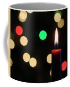 A Red Christmas Candle With Blurred Lights Coffee Mug