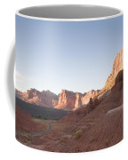 A Road Snakes Through The Parks Cliffs Coffee Mug