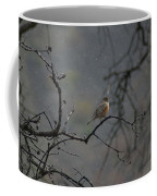 A Robin In Spring Snowfall  Coffee Mug