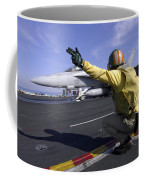 A Shooter Signals The Launch Of An Coffee Mug