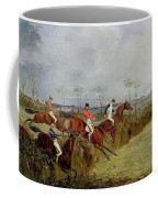 A Steeplechase - Taking A Hedge And Ditch Henry Thomas Alken Coffee Mug