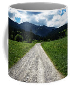 A Stone Path Through The Countryside Into The Forest Coffee Mug
