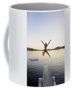 A Swimmer Jumps Off A Diving Board Coffee Mug
