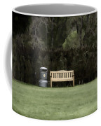 A Trash Can And Wooden Benches In A Small Grassy Area Coffee Mug