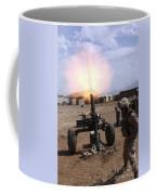 A U.s. Marine Corps Gunner Fires Coffee Mug