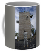 A U.s. Soldier Rappels Down A 40-foot Coffee Mug