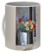 A Water Pitcher Holding Flowers Coffee Mug by Keenpress