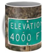 A Weathered Elevation Sign On Highway Coffee Mug