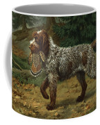 A Wire-haired Pointing Griffon Holds Coffee Mug