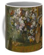 A Woman Seated Beside A Vase Of Flowers Coffee Mug