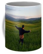 A Young Boy Runs Through A Field Coffee Mug