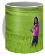 A Young Girl In A Folk Costume Plays A Vivaro In A Green Rice Fi Coffee Mug