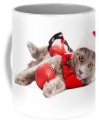 Adorable Christmas Kitten Over White Coffee Mug