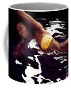 African American Woman In Bikini Lying In Black Water Coffee Mug