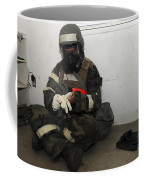 Airman Dons His Chemical Warfare Coffee Mug by Stocktrek Images