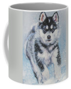 alaskan Malamute pup in snow Coffee Mug