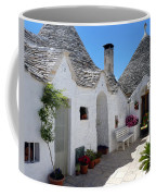 Alberobello Courtyard With Trulli Coffee Mug