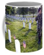 An Airman Renders Honors After Placing Coffee Mug by Stocktrek Images